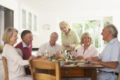 Friends Enjoying Lunch At Home Together - stock photo