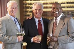 Friends Socializing At A Bar - stock photo