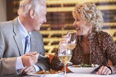 Senior Couple Having Dinner Together At A Restaurant Stock Photos