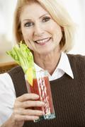 Woman Drinking A Bloody Mary Stock Photos