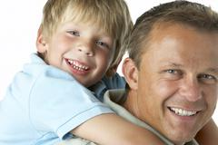 Father And Son Smiling Stock Photos
