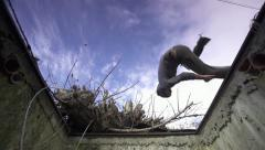 SLOW MOTION: Free runner does side flip over a manhole Stock Footage