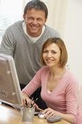 Couple Using Computer - stock photo