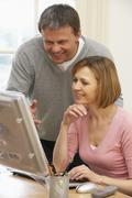 Couple Using Computer Stock Photos