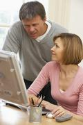 Couple Using Computer - stock photo