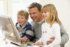 Father And Children Using Computer - stock photo