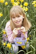 Young Girl In Daffodils At Easter Stock Photos
