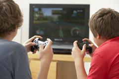Two Boys Playing With Game Console - stock photo
