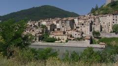 Sisteron village at Durance river tilt up citadel la Baume Stock Footage