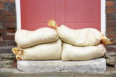 Sandbags Stacked In A Doorway In Preparation For Flooding Stock Photos