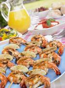Al Fresco Dining With Prawn Skewers Stock Photos