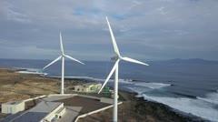 AERIAL: Wind turbines at seaside Stock Footage