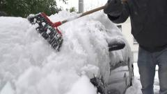 SLOW MOTION: Removing snow from a car Stock Footage