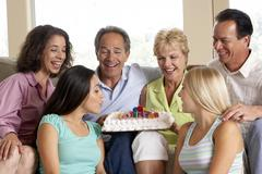 Two Families Celebrating A Birthday Together Stock Photos