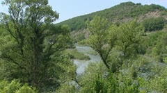 River Durance streaming in green valley, Sisteron, France Stock Footage