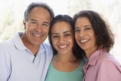 Stock Photo of Couple With Their Teenage Daughter