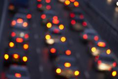 Tail Lights Shining Brightly In A Traffic Jam On Motorway - stock photo