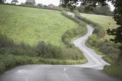 Road Winding Its Way Through The Countryside - stock photo