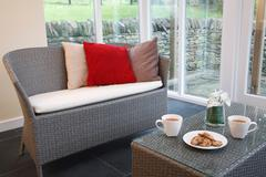 Rattan furniture in conservatory Stock Photos
