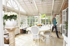 Woman Walking Through Conservatory Stock Photos