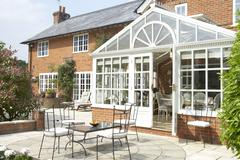 Exterior Of House With Conservatory And Patio Stock Photos