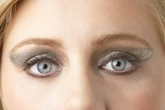 Close Up Of Young Woman Wearing Make Up - stock photo