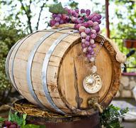 Barrel of wine with grape cones Stock Photos