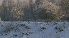 Snowy rural landscape + slope + grid Stock Footage