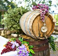 barrel of wine with grape cones - stock photo