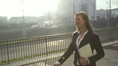 SLOW MOTION: Young businesswoman going to work in the morning Stock Footage