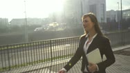 Stock Video Footage of SLOW MOTION: Young businesswoman going to work in the morning