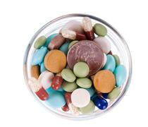 Fifty cents in saucer full of pills Stock Photos