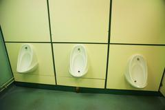 urinals in a publc convenience - stock photo