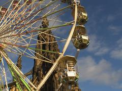 funfair and scots memorial, edinburgh, scotland - stock photo