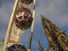 Funfair and scots memorial, edinburgh, scotland Stock Photos