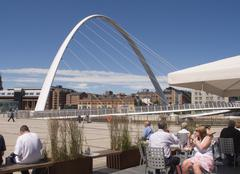 cafe and gateshead millennium bridge, newcastle on tyne - stock photo