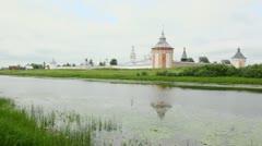 Bird flys over river, Saviour Prilutskyl Monastery at other side Stock Footage