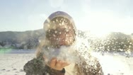 Stock Video Footage of SLOW MOTION: Young woman blowing snow