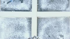 Three new year presents boxes near frozen window Stock Footage