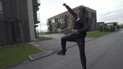 SLOW MOTION: Young businessman gets good news over digital tablet Stock Footage