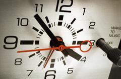 alarm clock set to six thirty - stock photo