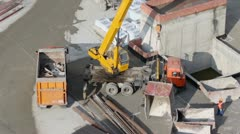 Labourers use crane to load lorry, view from above Stock Footage