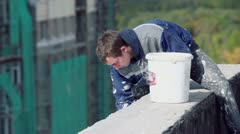 Worker smooth wall of residential complex Elk Island Stock Footage