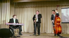 Musical trio band play music on stage during PolitProsvet award Stock Footage
