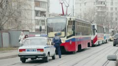 Policeman walk by street with tramways at day. Stock Footage