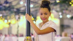 Young girl smiles and poses near decorative lamppost Stock Footage