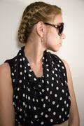 Girl in sunglasses on  light background Stock Photos