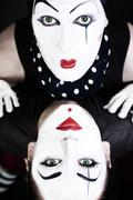 double portrait mimes with green eyes - stock photo