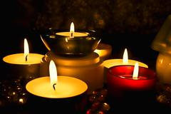 group of candles against a dark background - stock photo
