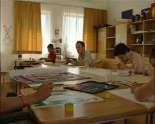Art workshop for mentally handicapped artists with teacher Stock Footage